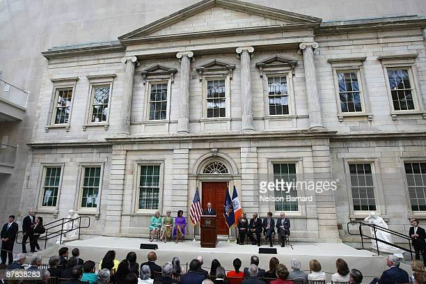 First lady Michelle Obama listens as New York City Mayor Michael R Bloomberg speaks at the ribbon cutting ceremony to officially reopen the Charles...