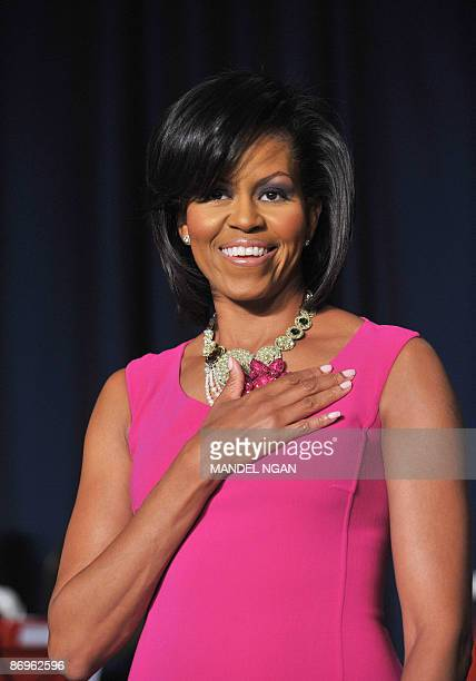 US First Lady Michelle Obama listens to the national anthen at the White House Correspondents� Association annual dinner on May 9 2009 at the...
