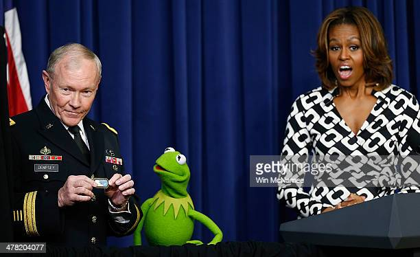 S first lady Michelle Obama looks on as Chairman of the Joint Chiefs of Staff Gen Martin Dempsey presents a special award to Kermit the Frog during a...