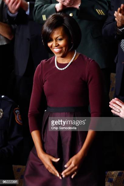 S first lady Michelle Obama looks on before her husband US President Barack Obama's speech to both houses of Congress during his first State of the...