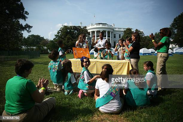 S first lady Michelle Obama particiaptes in a knottying session with fourthgrade Girl Scouts during the firstever White House Campout June 30 2015 at...