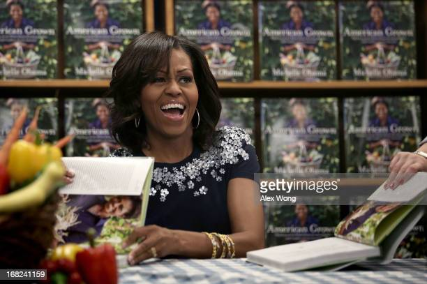 S first lady Michelle Obama participates in a book signing May 7 2013 at the Politics and Prose Bookstore in Washington DC Michelle signed autographs...