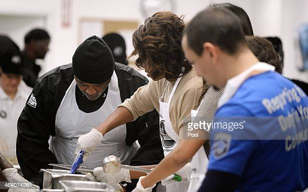 First Lady Michelle Obama participates in a community service project at the D.C Central Kitchen in celebration of the Martin Luther King, Jr. Day of...