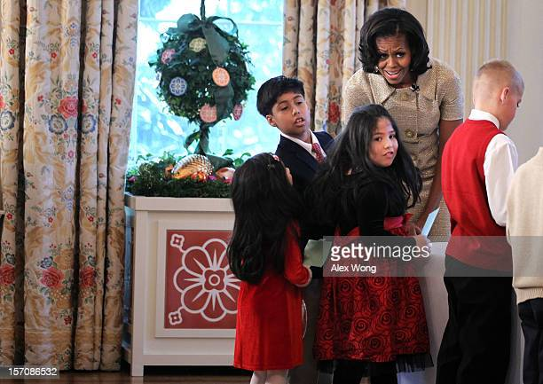 S first lady Michelle Obama participates in craft activities with military children at the State Dining Room after a preview of the 2012 White House...