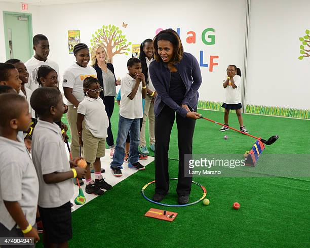 First Lady Michelle Obama plays a game of snag putting with children during a visit to the Gwen Cherry Park NFL/YET Center as she celebrates the 4th...