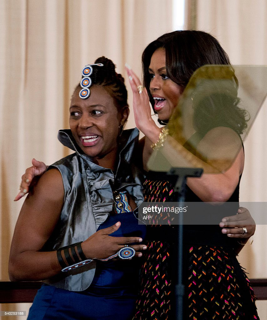 US First lady Michelle Obama pose for a photo with Ciiu Waweru Waithaka of Kenya, during a dinner to celebrate The White House Summit on the United State of Women at Department of State in Washington, DC on June 14, 2016. / AFP / Jose Luis Magana