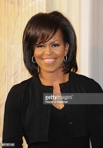 First Lady Michelle Obama poses as she arrives to attend the spouses evening on April 3 2009 in Baden Baden Germany Heads of state foreign ministers...