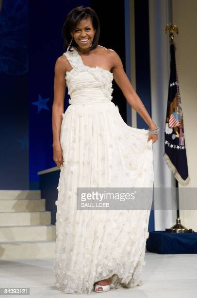 First Lady Michelle Obama poses during the Midatlantic Regional Inaugural Ball at the Washington Convention Center in Washington DC January 20 2009...