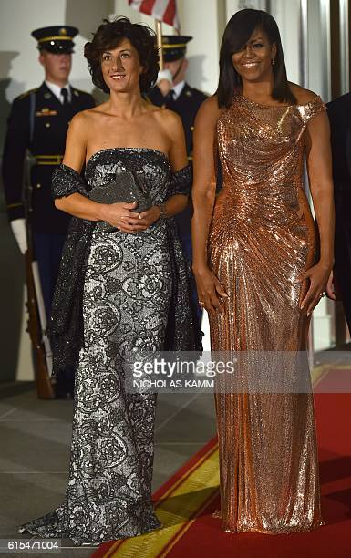 US First Lady Michelle Obama poses for a photo as she welcomes the wife of Italian Prime Minister Agnese Landini on the North Portico of the White...