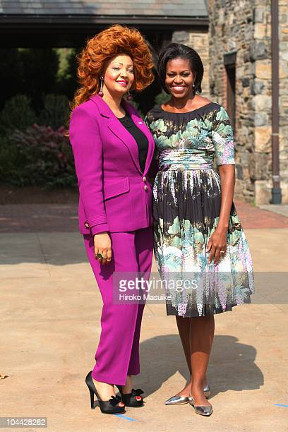 S First Lady Michelle Obama poses for photograph with First Lady of Cameroon Chantal Biya before touring Stone Barns Center for Food and Agriculture...