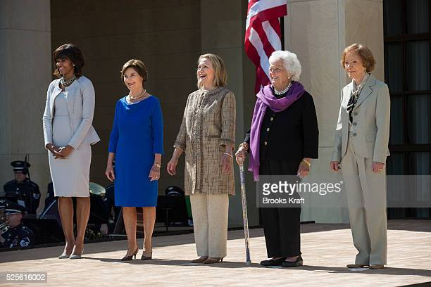First Lady Michelle Obama poses with former first ladies Laura Bush, Hillary Clinton, Barbara Bush and Rosalynn Carter as they attend the dedication...