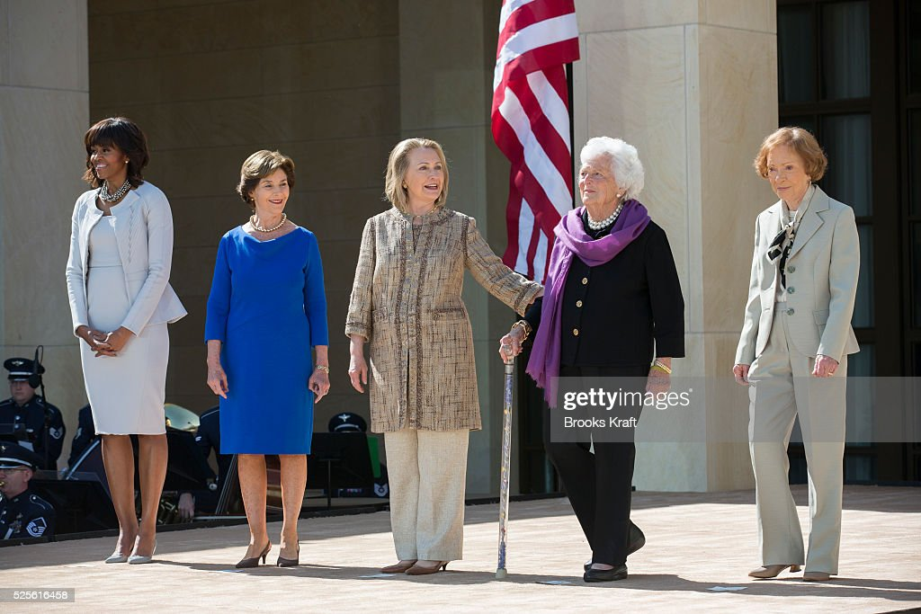 U.S. First Lady Michelle Obama (L) poses with former first ladies (2nd L-R) Laura Bush, Hillary Clinton, Barbara Bush and Rosalynn Carter as they attend the dedication ceremony for the George W. Bush Presidential Center in Dallas.
