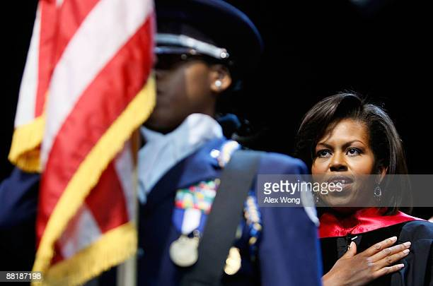 S first lady Michelle Obama put her hand on her heart as she listens to the national anthem during the commencement for the Washington Math Science...