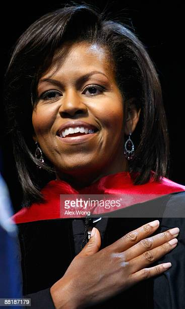 S first lady Michelle Obama puts her hand on her heart as she listens to the national anthem during the commencement for the Washington Math Science...