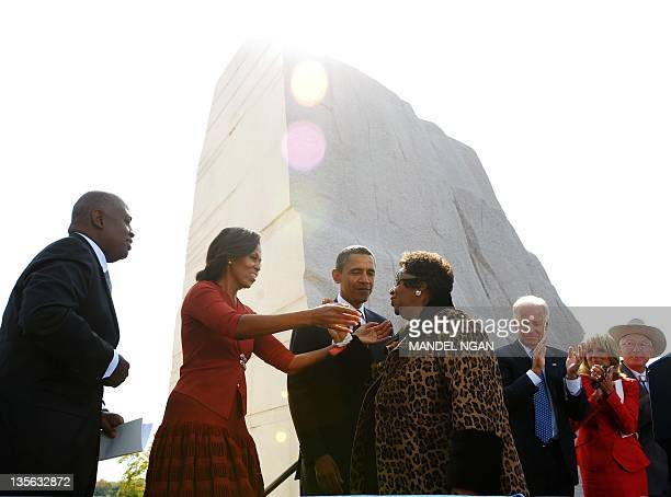 First Lady Michelle Obama reaches out to embrace Aretha Franklin as President and CEO of the Martin Luther King Jr National Memorial Project...