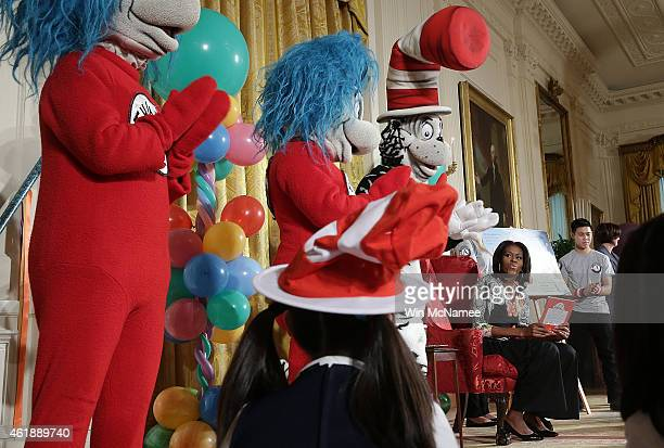 S first lady Michelle Obama reads a Dr Seuss book to local school children in the East Room of the White House on January 21 2015 in Washington DC As...