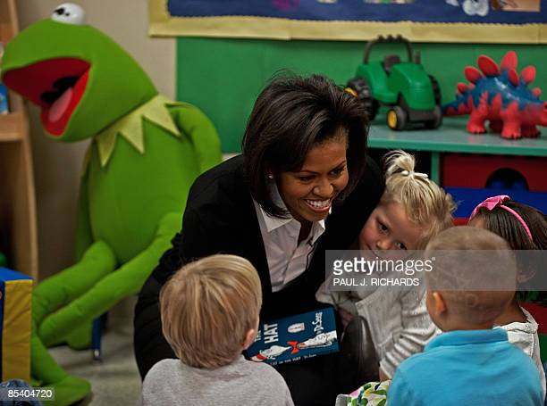 US First Lady Michelle Obama reads Dr Seuss's Cat In The Hat to 3 and 5yearold children at the Prager Child Development Center for military families...