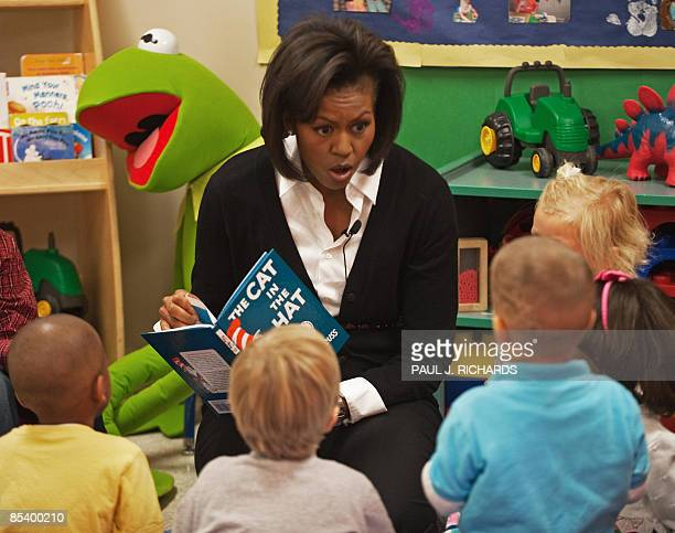 US First Lady Michelle Obama reads The Cat In The Hat by Dr Seuss to young children at the Prager Child Development Center for military families...