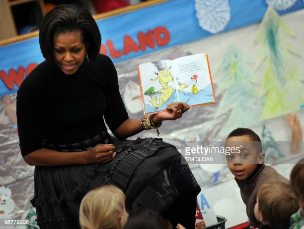 US First Lady Michelle Obama reads the classic Dr Seuss book 'Green Eggs and Ham' to children at the US Department of Labor Day Care Center on...