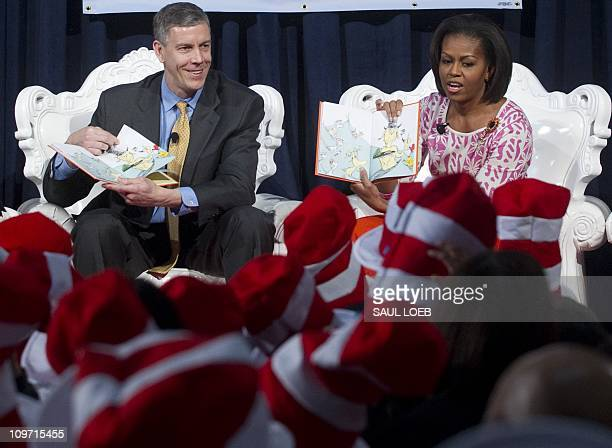 US First Lady Michelle Obama reads the Dr Seuss book Green Eggs and Ham alongside Secretary of Education Arne Duncan to elementary school students...