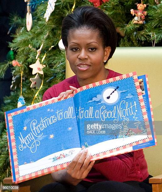 First Lady Michelle Obama reads 'Twas the Night Before Christmas to children during a visit to the Children�s National Medical Center in Washington...