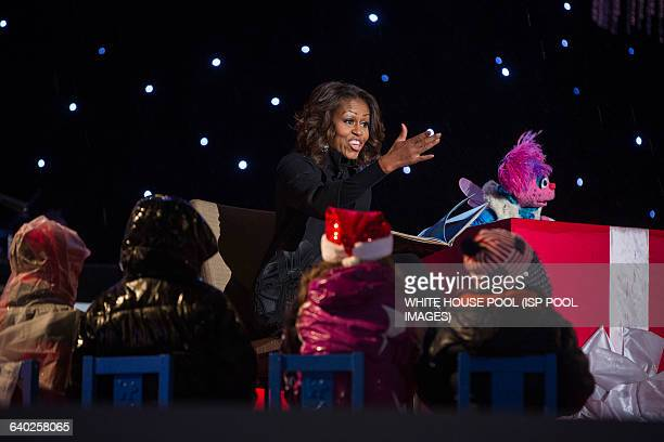 US First Lady Michelle Obama reads 'Twas the Night Before Christmas' with Sesame Street puppet Abby Cadabby during the 91st National Christmas Tree...