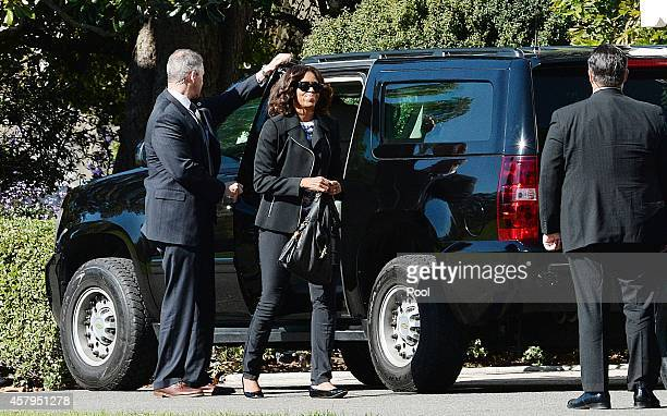 First lady Michelle Obama returns to the White House after with U.S. President Barack Obama after attending a parent/teacher conferences for their...