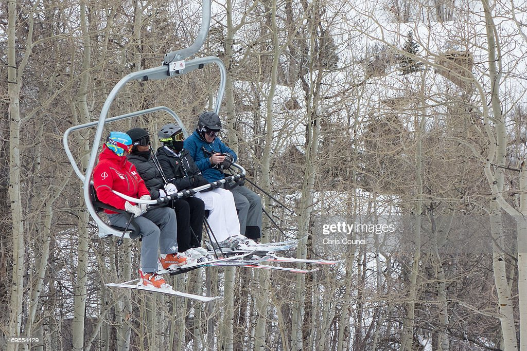 U.S. first lady Michelle Obama (2L) rides a chairlift during her ski vacation at Buttermilk Mountain on February 15, 2014 in Aspen, Colorado. This is the third year in a row that Obama has vacationed in Aspen over the long President's Day weekend.