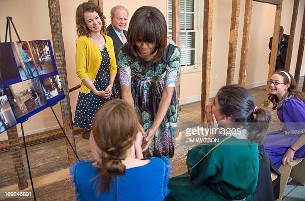 US First Lady Michelle Obama says hello to 6th graders from Fairfax Viginia's Willow Springs Elementary School during a surprise visit to the Decatur...