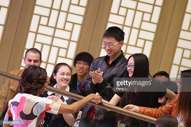 S First Lady Michelle Obama shakes hands with Chinese students after delivering a speech at the Stanford Center at Peking University on March 22 2014...