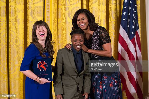First Lady Michelle Obama shares a laugh with awardee The Theater Offensive True Colors Out Youth Theater at the 2016 National Arts and Humanities...