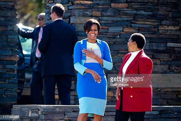 US First Lady Michelle Obama shares a light moment with Hector Pieterson's sister Antoinette Sithole at the Hector Pieterson memorial site on June 22...