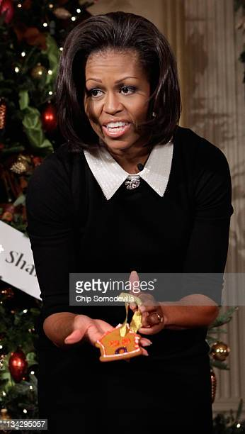First lady Michelle Obama shows her handmade cookie Christmas ornament to the press while hosting children of active duty military service members in...