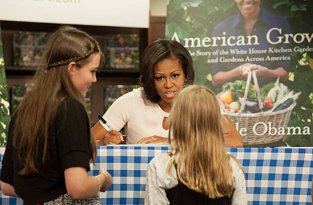 First Lady Michelle Obama Signs Her Book American Grown