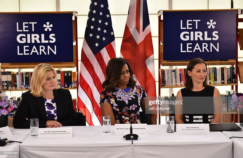 US First Lady Michelle Obama (C) sits between The UK Department of International Development's Justine Greening and (L) returned Peace Corps Volunteer Bina Contreras (R) during a 'Let Girls Learn' meeting as part of the 'Let Girls Learn Initiative' at the Mulberry School for Girls on June 16, 2015 in London, England. The US First Lady is travelling with her daughters, Malia and Sasha and her mother, Mrs. Marian Robinson, to continue a global tour promoting her 'Let Girls Learn Initiative'. The event at the school was to discuss how the UK and USA are working together to expand girl's education around the world.