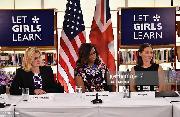 First Lady Michelle Obama sits between The UK Department of International Development's Justine Greening and returned Peace Corps Volunteer Bina...
