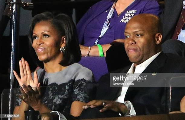 First lady Michelle Obama sits with her brother Craig Robinson in a box during day two of the Democratic National Convention at Time Warner Cable...