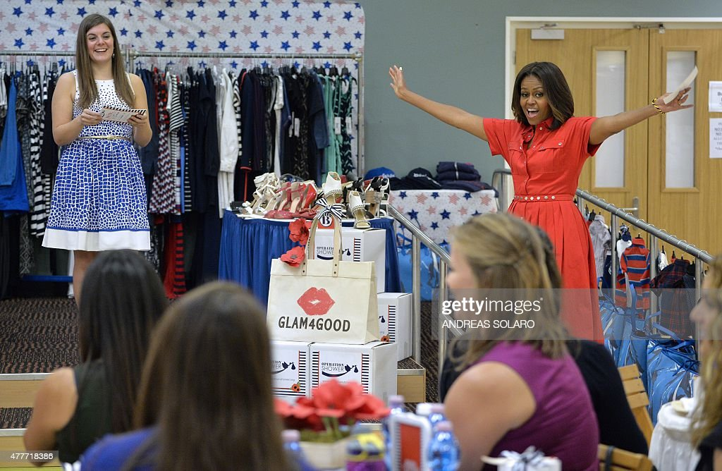 US First Lady Michelle Obama (R) smiles as she visits mothers-to-be at the United States and Nato military base in Vicenza on June 19, 2015.
