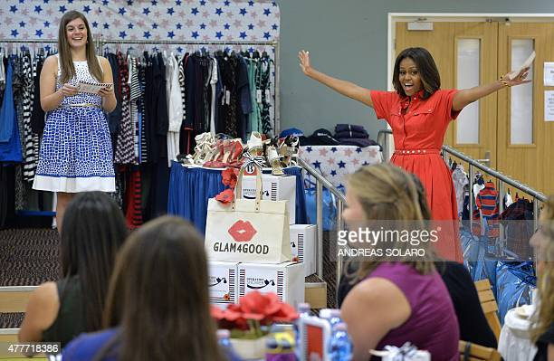 US First Lady Michelle Obama smiles as she visits motherstobe at the United States and Nato military base in Vicenza on June 19 2015 AFP PHOTO /...
