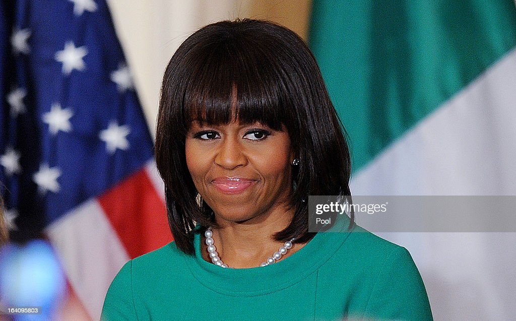 U.S. First lady Michelle Obama smiles during a reception for Ireland's prime minister in the East Room of the White House on March 19, 2013 in Washington, DC. President Obama met with Irish Prime Minister Enda Kenny prior to the annual St. Patrick's Day lunch hosted at the Capitol.