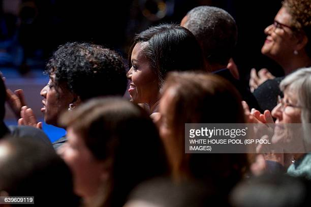 """First Lady Michelle Obama smiles during an """"In Performance at the White House"""" event with U.S. President Barack Obama, not pictured, in the East Room..."""