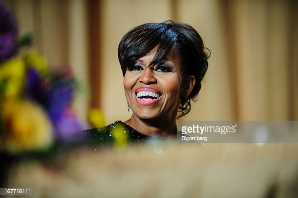 First Lady Michelle Obama smiles during the White House Correspondents' Association dinner in Washington District of Columbia US on Saturday April 27...