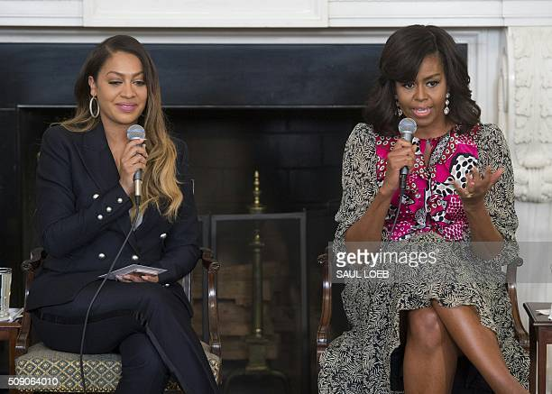 US First Lady Michelle Obama speaks alongside television personality La La Anthony during a daylong dance workshop for local students to highlight...
