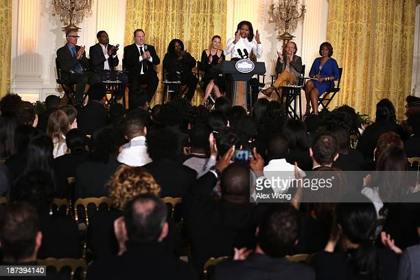 S first lady Michelle Obama speaks as director David Frankel director Ryan Coogler production executive Harvey Weinstein actress Whoopi Goldberg...