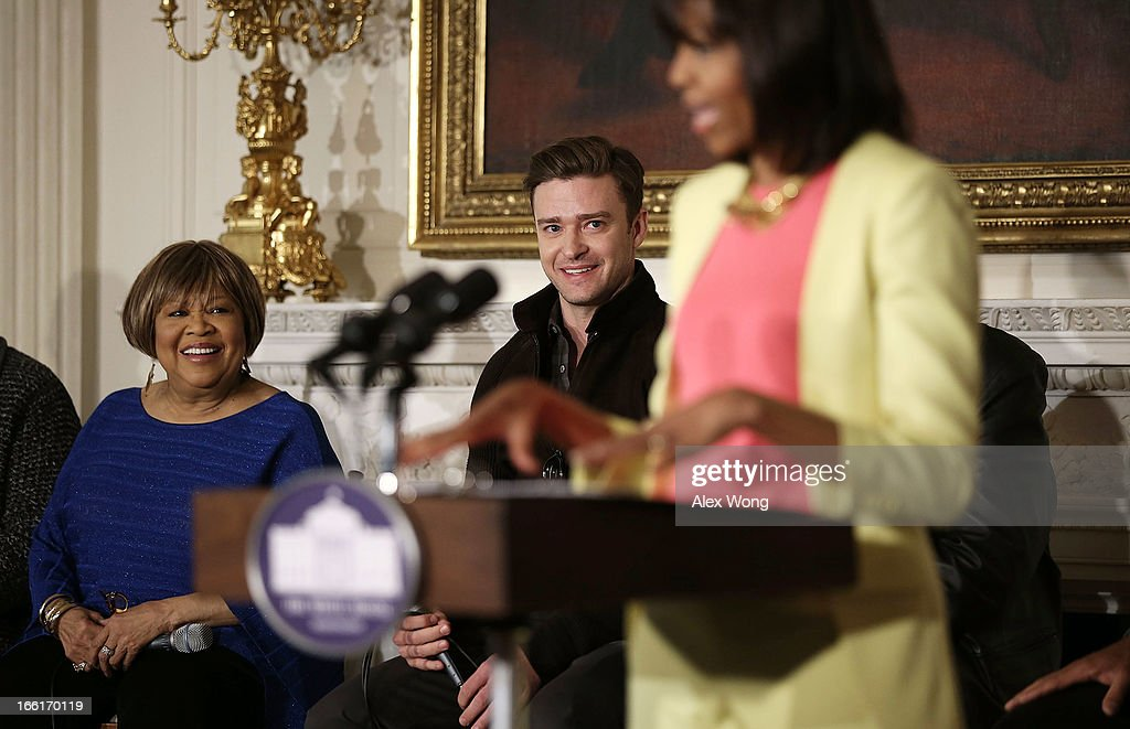 U.S. first lady Michelle Obama speaks as musicians Mavis Staples (L) and Justin Timberlake (2nd L) listen during an interactive student workshop at the State Dining Room of the White House April 9, 2013 in Washington, DC. The first lady hosted middle and high school students from across the country to take part in the workshop on 'Soulsville,