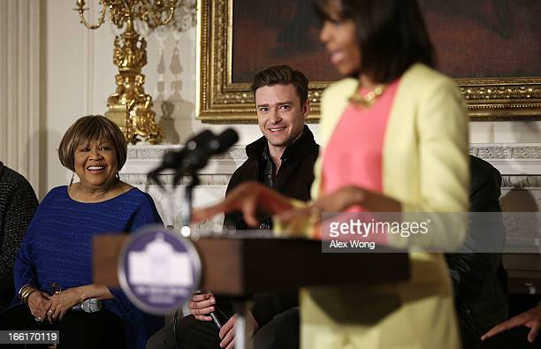 S first lady Michelle Obama speaks as musicians Mavis Staples and Justin Timberlake listen during an interactive student workshop at the State Dining...