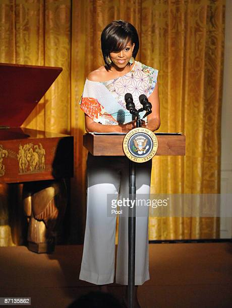 First lady Michelle Obama speaks as she and President Barack Obama host An Evening of Poetry Music and the Spoken Word in the East Room of the White...
