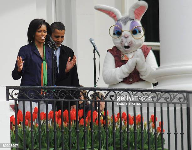 First Lady Michelle Obama speaks as US President Barack Obama and the Easter Bunny look on from the Truman balcony of the White House during the...