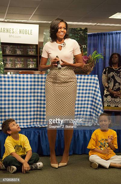 First Lady Michelle Obama speaks before signing her book 'American Grown The Story of the White House Kitchen Garden and Gardens Across America' at a...