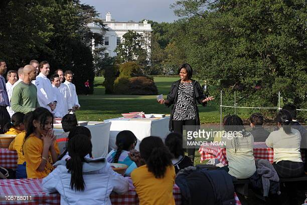 First Lady Michelle Obama speaks before the harvesting of the White House Kitchen Garden October 20 2010 on the South Lawn of the White House in...